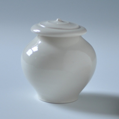 "Handmade porcelain all white keepsake pet urn. Urn capacity of 10 cu. Measurements of 3"" x 3"" x 3""."