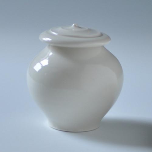 "Handmade porcelain all white keepsake pet urn. Urn capacity of 10 cu. Measurements of 3"" x 3"" x 3""."