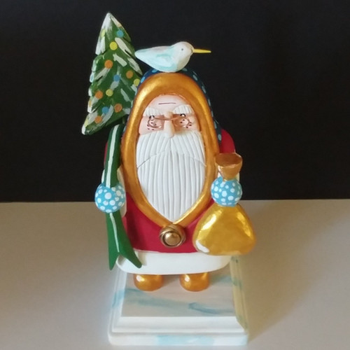 """Individual hand carved red Santa by artist Bob Smith. The Santa has a removable bird and tree. Height on base of the Santa is 8.25"""""""