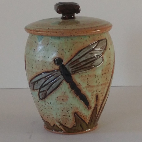 Handmade ceramic small size urn with dragonfly design.  Individually made by an American Artisan