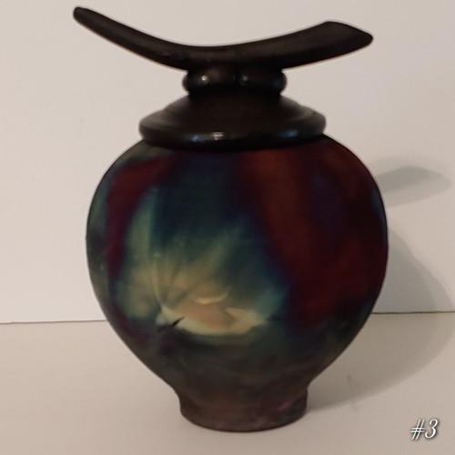 Other side of handmade raku cremation pet urn.