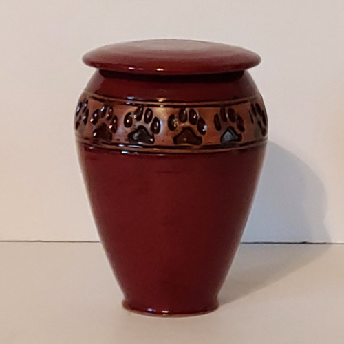 Tall Dark Red Cremation Ceramic Pet Urn with Paw Print design band.