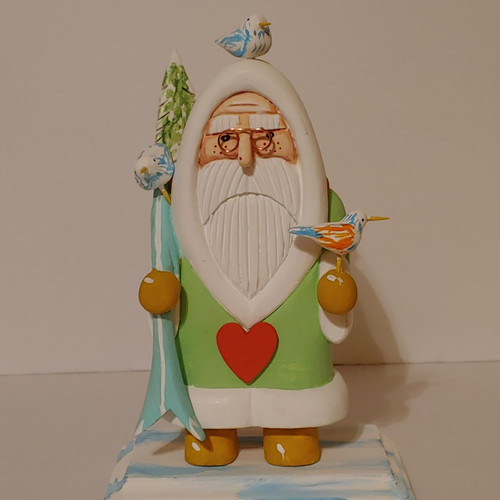 Hand carved and hand painted wooden santa by artist Bob Smith. The colors on this beautifully detailed hand carved santa are lime green, turquoise and yellow.