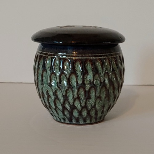 Small handmade pottery textured pet urn for small size pet's ashes.