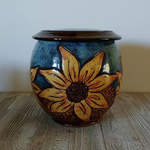 Dark blue urn with yellow sunflowers