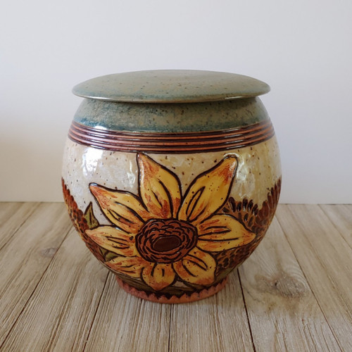 Ceramic handmade cremation urn with Sunflowers.