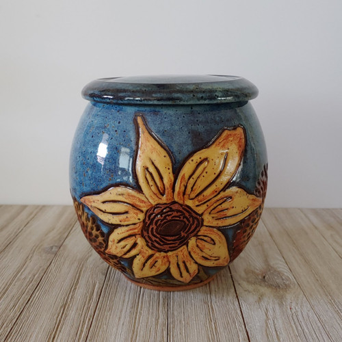 Large round blue glazed ceramic urn with Sunflower