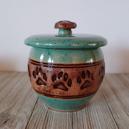 Small ceramic pet urn in sea green glaze with paw prints design, handmade