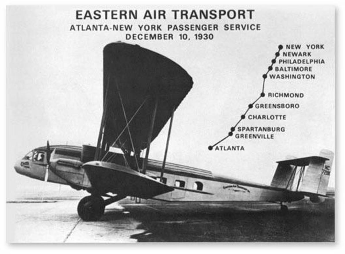 "Eastern Air Transport Metal Sign. Measures 28"" X 14"""
