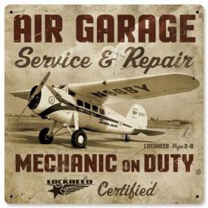 "Lockheed Vega ""Air Garage"" Metal Sign. measures 12"" X 12""."