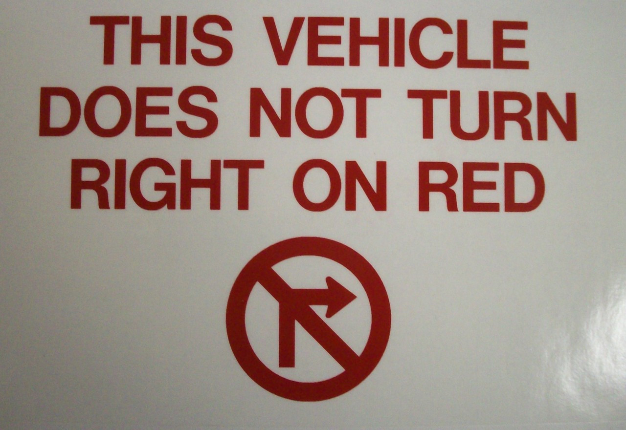 SB223FA, This Vehicle Does Not Turn Right On Red (Face Adhesive)