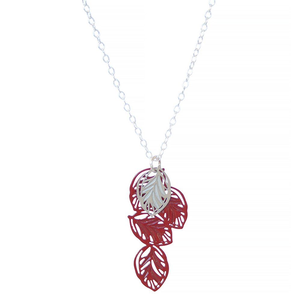 A multi leaf pendant with fine leaf vein detail. Contrasting colours of stainless steel and powdercoated colour red with sterling silver chain
