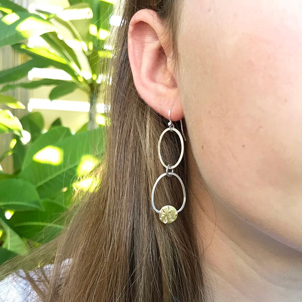 Embrace dangle earrings sterling silver and brass on  odel by Robin Wells