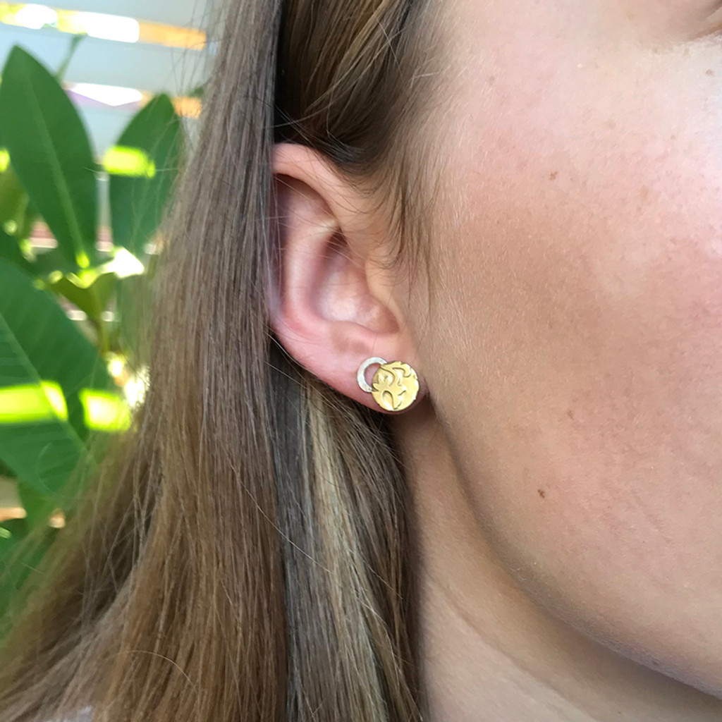 Hug studs sterling silver and brass on model by Robin Wells