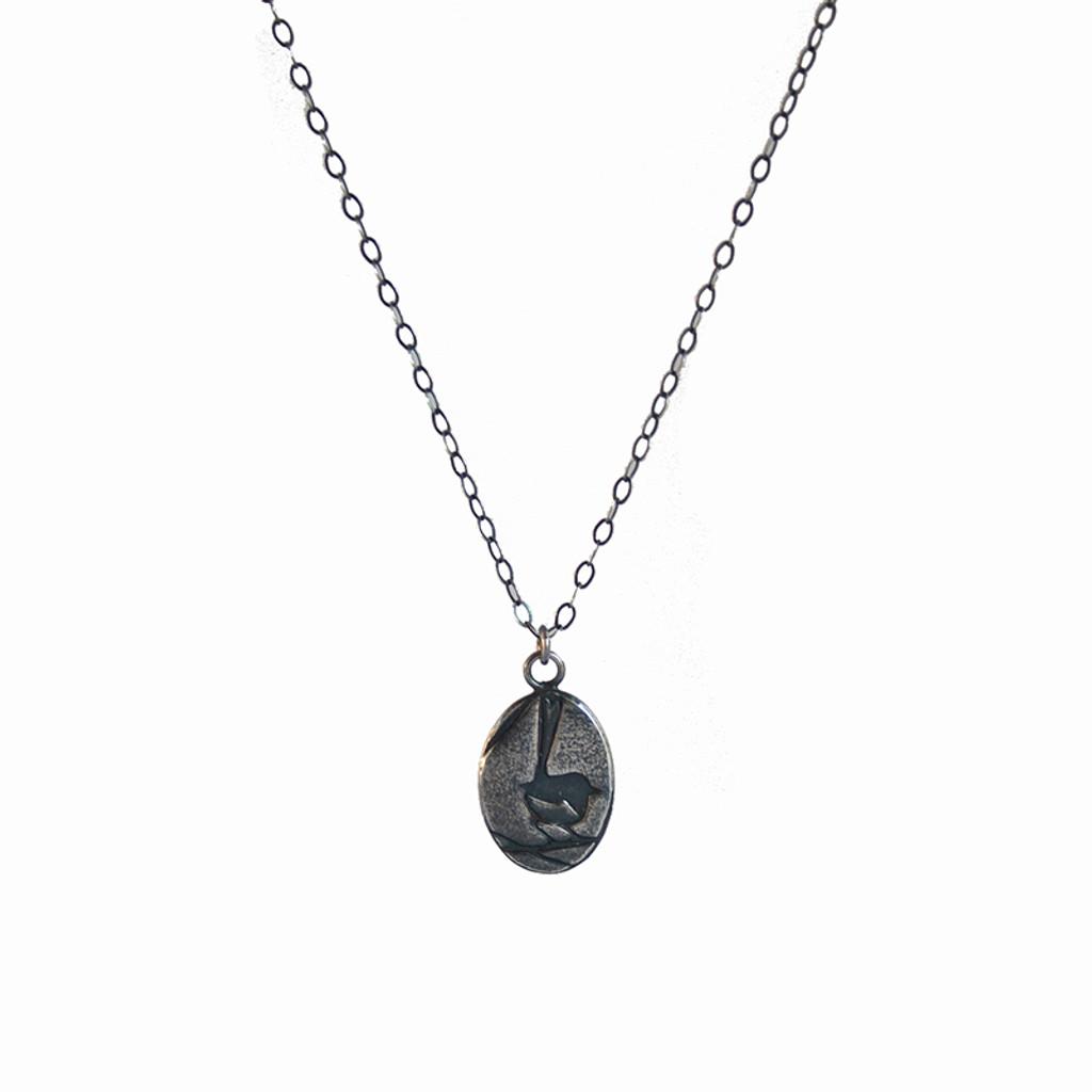 Embossed wren sterling silver charm pendant