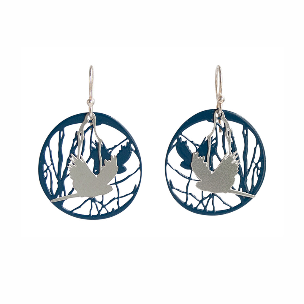 Bird and branch steel earrings with dark blue background