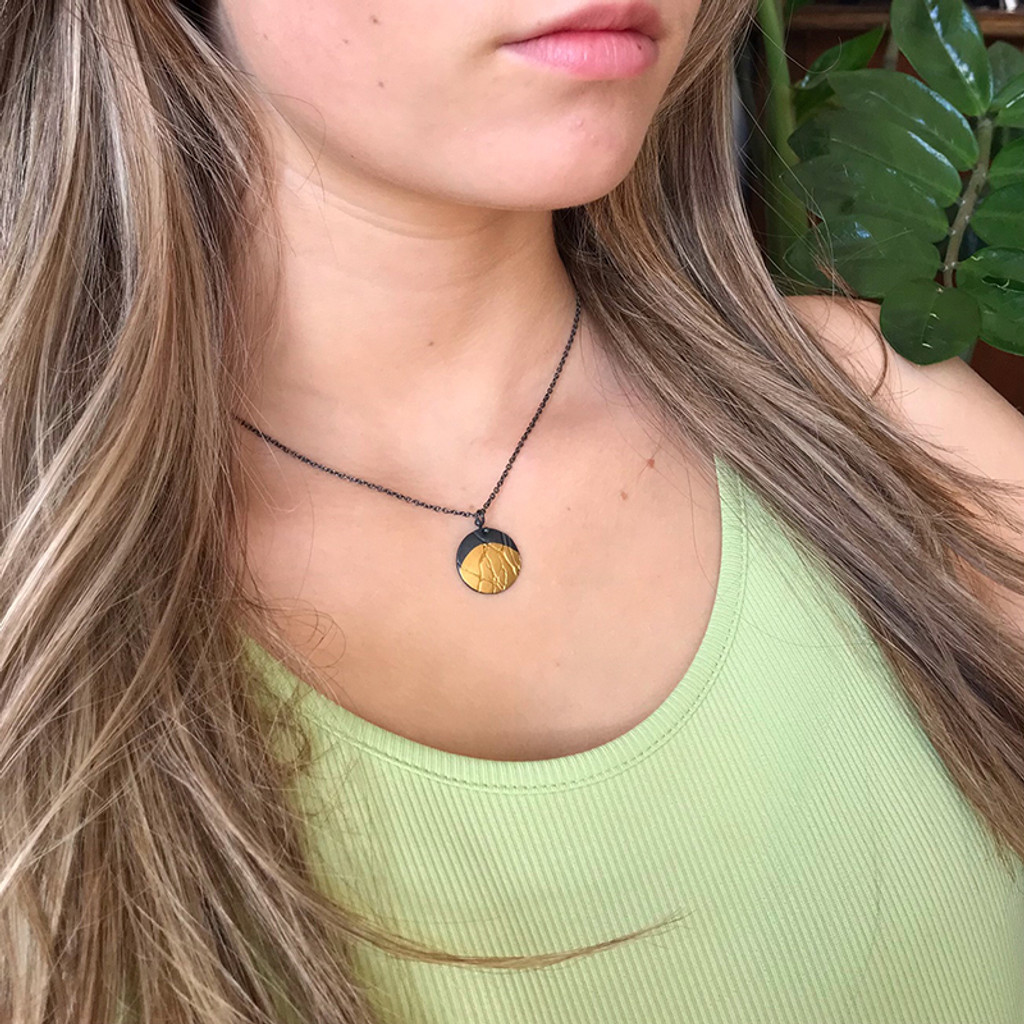 Moonrise gold and silver pendant