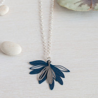Blue design. Elegant fan shape pendant made up of layered leaves based on the foliage of the native Eremophila plant. Created from light weight stainless steel, this is a two part pendant. The colour is a durable powdercoated finish contrasting with the soft grey of a stainless steel leaf motif.