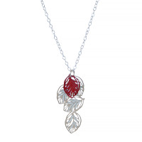 A multi leaf pendant with fine leaf vein detail. Contrasting colours of stainless steel and powdercoated red colour with sterling silver chain