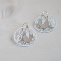 Bird and branch steel earrings with white background