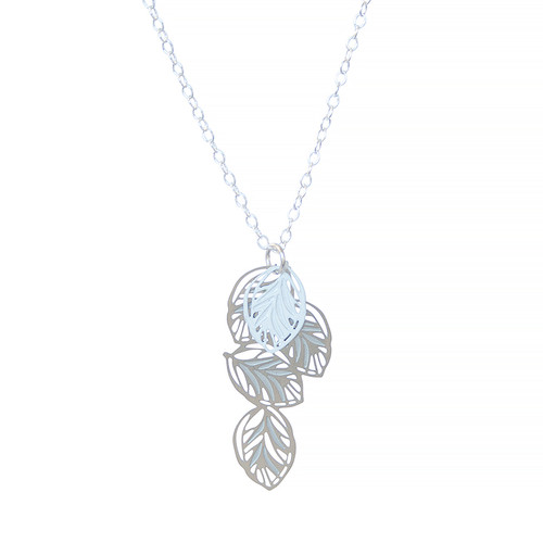 A multi leaf pendant with fine leaf vein detail. Contrasting colours of stainless steel and powdercoated white colour with sterling silver chain