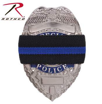 "Show your respect and support for Police and Law Enforcement Officials with Rothco's Thin Blue Line Mourning Band.  Thin Blue Line Mourning Band Elasticized To Fit Onto A Badge Measures 7/8"" Wide X 4 1/4"" Circumference Black Band With Thin Blue Line Center The Thin Blue Line Shows Respect And Support For Police And Law Enforcement Officials. Proceeds From This Purchase Benefit Families Of Fallen First Responders"