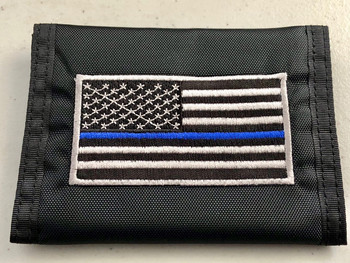Features 5 Pockets Ideal For Money, Cards, And ID Made Of 100% Nylon For Durability Hook And Loop Closure The Thin Blue Line Is A Symbol Of Respect And Support For Police And Law Enforcement Official Tri-Fold Style For Maximum Storage