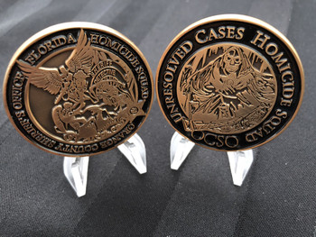"GOLD TONE ORANGE CTY SHERIFF HOMICIDE UNIT CHALLENGE COIN RARE   ""ROLLIN WITH THE REAPER""   AWESOME LOGOS AND COMMAND SIZE 1.75   THESE ARE DEPUTIES LOOKING FOR KILLERS...   We salute these dedicated law enforcement officers who see humans at their worst!"