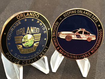 ORLANDO FL POLICE CHALLENGE COIN RARE  LARGE AGENCY, HIGH MORAL, GREAT  COPS.  DRIVE AWAY IN THEIR CRUISER !  PATCH DESIG ON FLIP SIDE  1.50.  FULL . COLOR DESIGN
