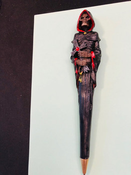 Grim Reaper Ball Point Pen holds the holds a crucifix with a faux ruby accent