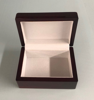 Rosewood stained piano finish jewelry box with beige felt lining.