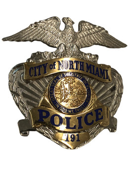 NORTH MIAMI FL POLICE CAP BADGE