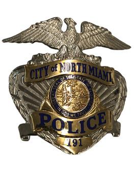 NORTH MIAMI FL POLICE CAP BADGE
