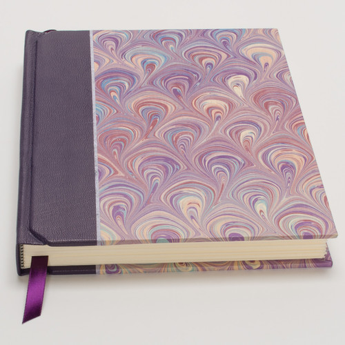 Italian hand-marbled paper and purple goat leather cover.