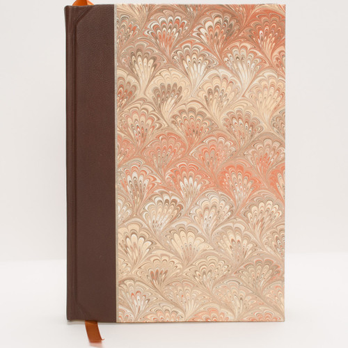 Large brown leather journal with marble cover