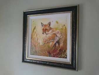 Original framed in a distressed black/gold frame with a white slip