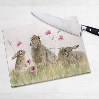 Glass chopping board-Poppy Appeal. Artwork by Kay Johns