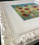 White ornate frame with wide white slip, original floral artwork by Kay Johns