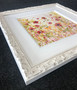 White ornate frame with wide white slip, artwork by Kay Johns