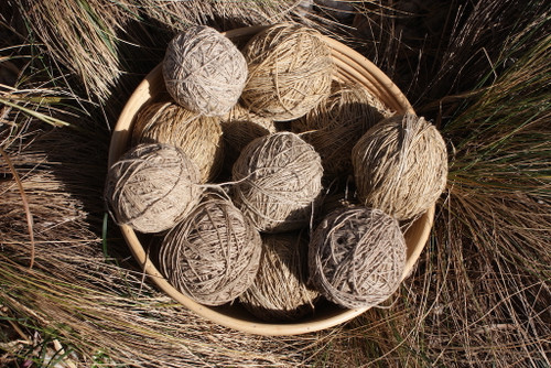 Hemp is the darker yarn and is coarse and strong.
