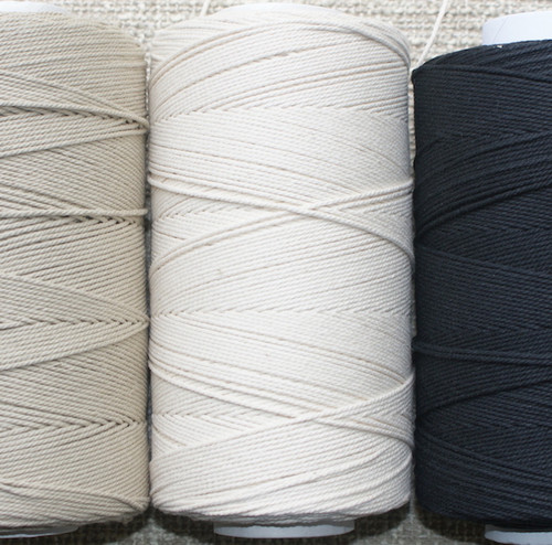 Natural/undyed in the centre. Beige and black either side