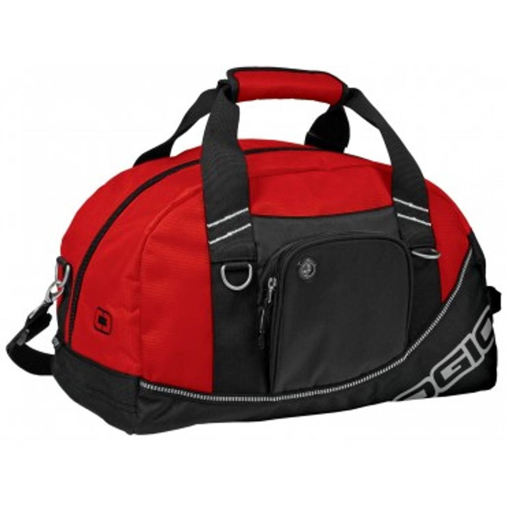 "This BHS-branded Ogio Half-Dome Duffel is designed with the locker in mind.  Carry it all in one bag, and easily fit it in a standard gym locker.  Gym goers can also get their gear in and out in a zip with a large main front zippered compartment.   When you're ready to leave, use the side grab handle, or the top two Velcro handles, to quickly pull it back out of the locker, put your gear back in the bag, and slip the over-the-shoulder strap on for a comfortable carry.  Includes a built-in audio pocket as a hidden front enclosure.   Available in Red. Dimensions:  17"" L x 10"" W x 10"" H."