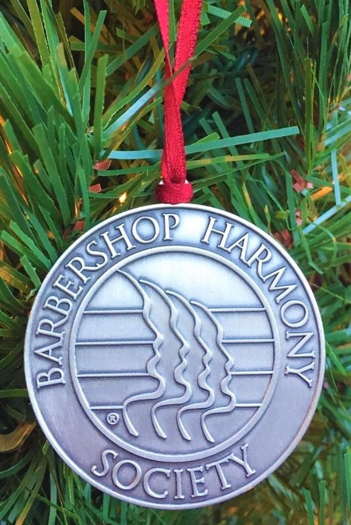 "Trim your tree with this bronze Barbershop Harmony Society logo ornament with a nickel finish.  Ornament is 2"" round.  This ornament creates and fosters an emphasis on elegance and class with its simplistic design.   Paired with a gorgeous, solid red colored barberpole themed string to hang upon your tree, or anything else you so desire, and as you see fit."