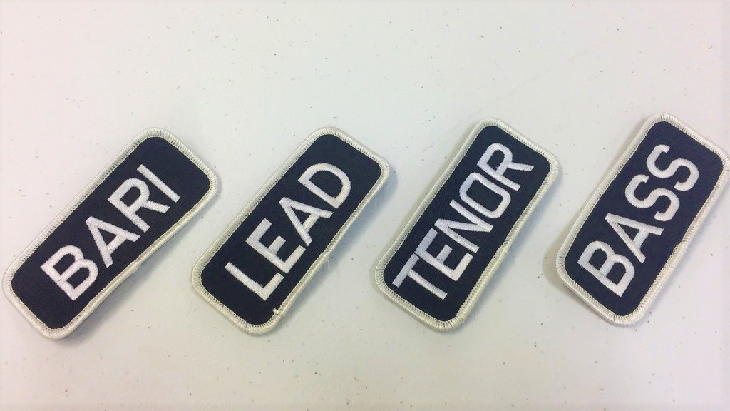 These simply designed patches are ideal for letting people know what part you sing.   Tenor, Bass, Baritone, Lead...maybe all four!  They can be used on bags, jackets, shirts.  Easily applied with low heat. Use an iron and wax paper to affix your patch to almost any type of clothing.  Perfect for our Mechanic shirts.
