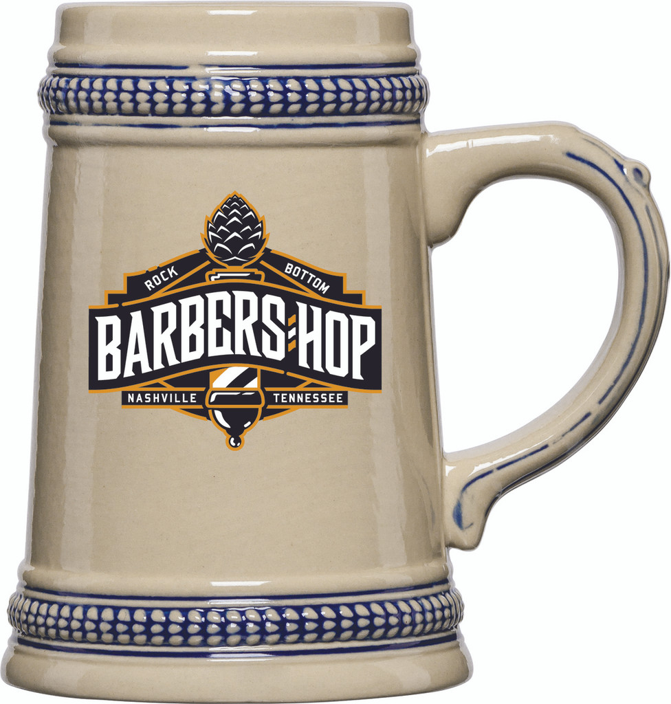 This 0.5L Blue Trim Ceramic Stein with our Barbers Hop Ale logo is the perfect vessel for a mug club, Oktoberfest, or a great addition to your favorite beverage collection.  With its traditional handled design and cobalt blue trim accents, it's a beautiful and eye-catching stein that your beer fans will love.  Made of durable stoneware, this stein is built to last and will always be in style.