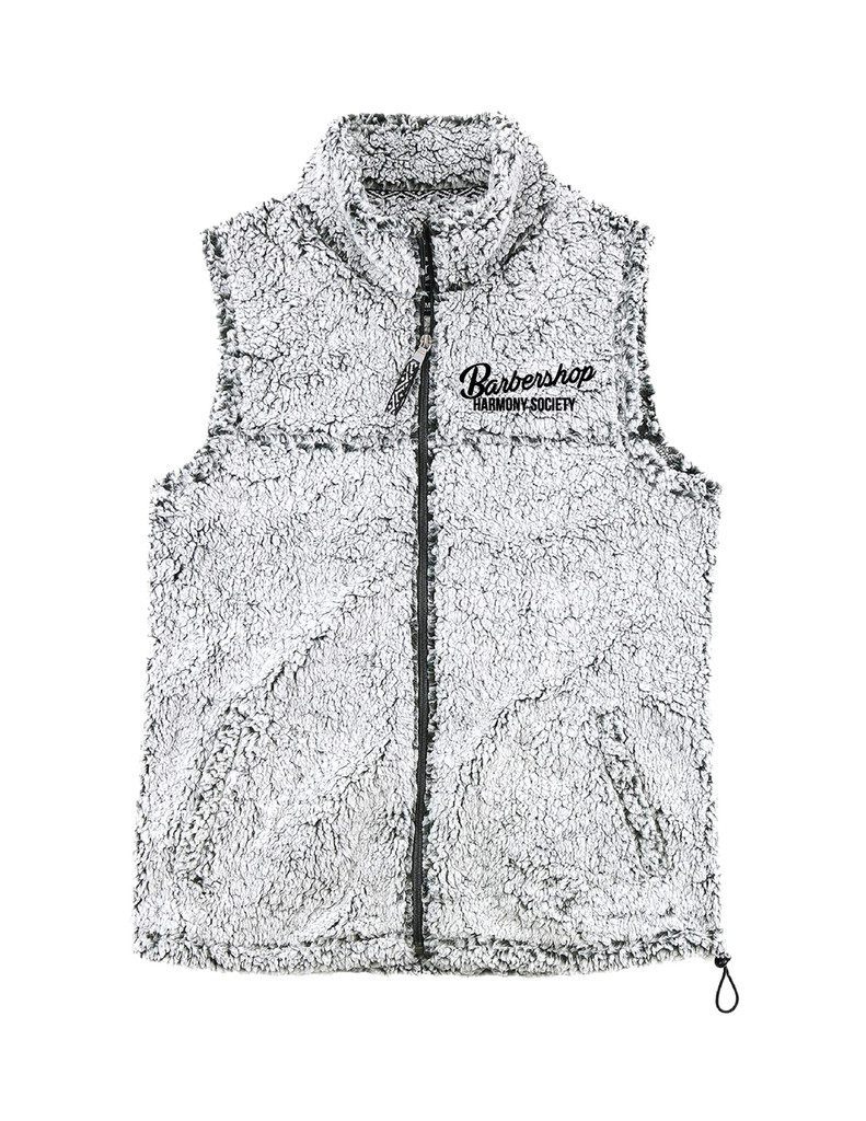 This Sherpa Vest is sure to keep you warm through the colder months of the year.   Embroidered with a retro-inspired logo, this is sure to be a soft and stylish addition to any wardrobe.   The bottom of this vest can tighten to ensure that no unwanted cold air will reach your torso.