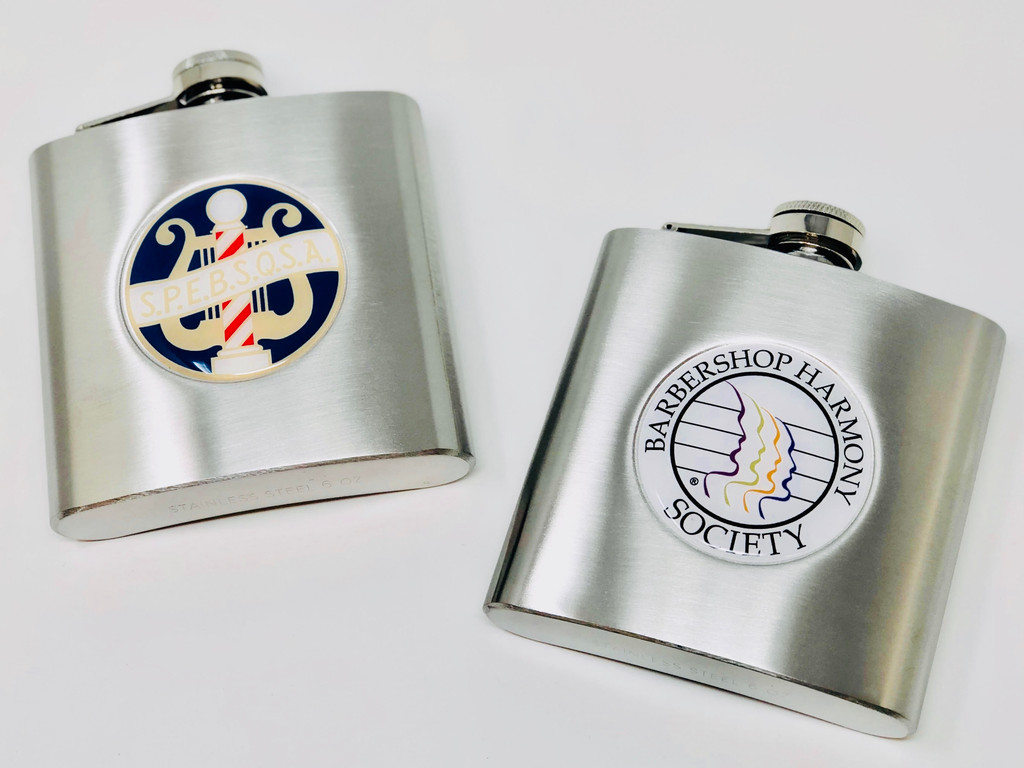 Both professional and personal, these flasks provide a nice, but elegant touch to any attire.  Made with a brushed silver finish.  Available in 2 Styles: BHS Logo or Vintage SPEBSQSA logo Size: 6 oz.