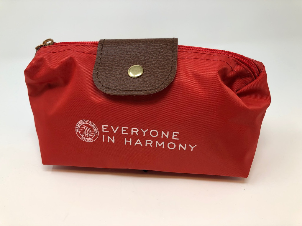 This small, compact cosmetic bag is perfect for on-the-go travelling.  Available in red, it can fit the essentials or be used as an ideal spot for emergency supplies.   It not only has a top zipper, but also utilizes a single flap enclosure to ensure extra security.
