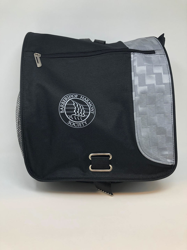 """The BHS Messenger Bag is a convenient travel commodity for work, school, conventions, and other events.    Made by Leed's, it is designed as a Gridlock Vertical Messenger Bag that can fit up to a 15"""" computer, as well as outer and internal storage for additional supplies, including notebooks and other essentials."""