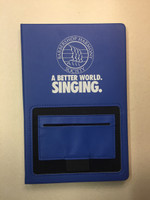 """Our BHS-branded kangaroo pocket journal is the perfect tool for journaling or note taking.  The elastic pocket on the front cover holds your business cards, sticky notes, and your cell phone.  A part of our """"A Better World. Singing."""" collection.   Available in colors royal blue (navy) and red."""